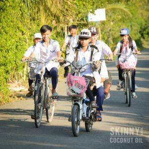 kids in vietnam riding bicycles